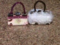 made from binder clips that are decorated, the larger the clip the bigger your purse decoration will be.  I just watched a video on youtube by typing in binder clip purses and it shows you different things you can make.  Have fun if you check it out