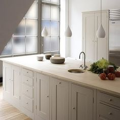 English inspired design with painted cabinetry and butcher block counter tops - with a twist (modern pendants)
