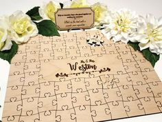 Symbolize your marriage with a puzzle that everyone can be a part of! This creative wedding guest book idea stands apart - just have each wedding guest sign a piece of it. | Guest Book Puzzle