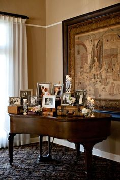 Beautiful Vignette on a grand piano for a wedding or just to display family photos. The suitcases give height, texture and interest.