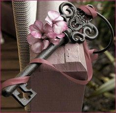 Pink ribbon, flowers, and key