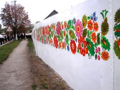 """120 meters of a fence painted by """"Petrykivka"""" in Dnipropetrovsk region - traditional Ukrainian style"""
