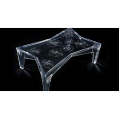 Wowza! Acrylic coffee table with sunbursts created by firing 16 .22 caliber  rounds into the piece. From BRC Design, one of a limited edition of five.