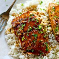 The BEST teriyaki salmon ever made completely from scratch in one skillet and served with fluffy gingered rice and lots of homemade teriyaki sauce!