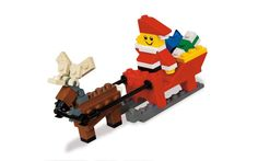 LEGO Santa Claus is coming to town. Send Santa Claus across the world with a sleigh full of gifts and a LEGO reindeer with moveable antlers to guide him. Lego Christmas, Christmas Gifts For Kids, Father Christmas, Christmas Crafts, Christmas Time, Christmas Ideas, Christmas Planning, Christmas Shopping, Holiday Fun