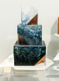 Watercolor, geode cake in blue. Square with gold and copper metallic edges.
