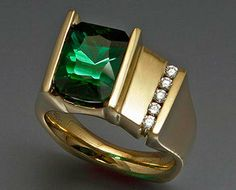 14k yellow gold ring with large green Tourmaline and Diamonds