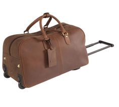 Leather & Canvas Flight Trolley A treat for frequent flyers or regular travellers, our trolley bag has a retractable handle concealed by a zipped compartment and sturdy rollers for smooth running. Size: L: x H: x W: x x Cabin Luggage, Trolley Bags, Travel Bags, Leather Bag, Rollers, Luxury, Canvas, Smooth, Handle