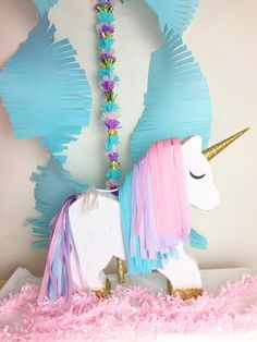 Piñata for unicorn birthday party. Shop for outfits and styles for every moment at www.bellethreads.com