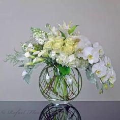 all white flower arrangement of orchids, hydrangeas, roses, calla lilies
