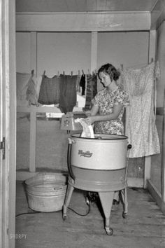 1938 Maytag washer    via shorpy.com Why they called it laundry DAY ! And yet my sister loved doing laundry !