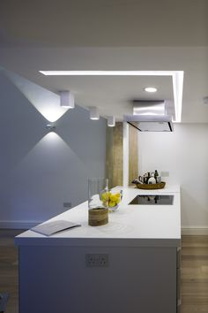 bulthaup b1 kitchen in Alpine White matt lacquer. Miele and Elica appliances. Corian worktops from Counter Production