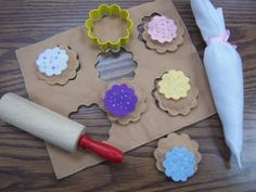 """""""Down around the corner in the bakery shop Were five little cookies with sprinkles on top… Along came someone with a nickel to pay And they bought a little cookie and they took it away!"""" I love this song and the dramatic play possibilities of the felt set!!!"""