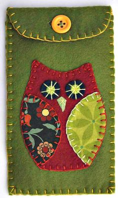 Handmade felt phone case with appliqued and embroidered owl motif, blanket-stitched edges, contrasting lining and a button fastening.7cm x 15cm /