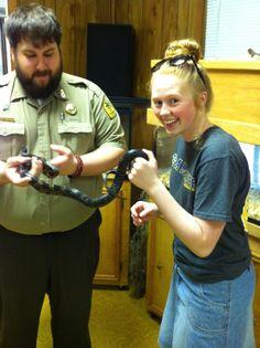 Kiley touching a snake
