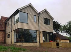 Large glass windows with Aluminium frames. Installed by Lite Haus UK