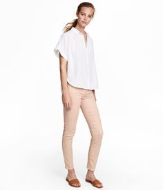 Check this out! 5-pocket, ankle-length pants in washed superstretch twill. Regular waist and skinny legs. - Visit hm.com to see more.