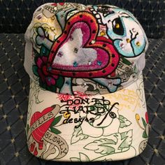 Ed Hardy cap ☠ Free Shipping ☠ 💯Authentic Ed Hardy baseball cap, iconic tattoo design with Swarovski crystals. Good condition, have some make up under forehead area, can be remove it at home. Ed Hardy Accessories Hats