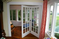 Folding Door to 3 or 4-Season Room by Archadeck in Old Greenwich CT 06870 for a room with radiant tile heat and coziness.