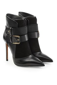BALMAIN - Dyed in classic black with a sharp pointed toe, these stiletto-heel ankle boots from Balmain are detailed with stretch fabric and velvet-soft suede for a high-low clash. Gold-tone hardware and contemporary buckles keep them current and cutting edge | STYLEBOP