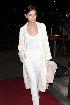 Who: Lily Aldridge What: Pastel Pink Bag Why: Model Lily Aldridge offsets her chic all-white ensemble with a pale pink tote—the ideal candy-colored hue for Spring.  Get the look now: Thakoon bag, $1,750, barneys.com.   - HarpersBAZAAR.com