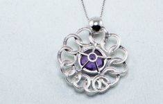 This large Pendant Necklace creates an instant great first impression with its dazzling rhodium plated fine 925 sterling silver and impressive amethyst zircon crystal crowning the centerpiece. It's a necklace that won't be ignored, standing out above the rest just like anyone who will wear it.  Comes in Aphrodite's Jewels Packaging Box! Amethyst Color, Crystal Crown, Flower Necklace, Centerpiece, Swarovski, Rest, Packaging, Pendant Necklace, Jewels