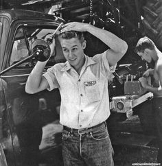 Farm boy slicking up for a night in town.  Colby, Kansas, 1953