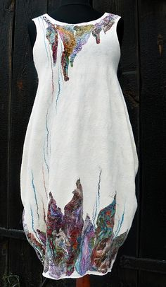 White dress by Diana Sencerek     LLee>> don't care for the bubble hem, but would Love to see this in white silk