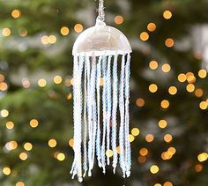 """Sequin Jellyfish Ornament #potterybarn A gorgeous reminder of ocean wonders, our sequined jellyfish brings extraordinary shimmer to your holiday tree. 3.25"""" diameter, 8"""" high; 4"""" cord Made of blown glass with a pearlized finish. Hand-strung sequins. Hangs from a natural jute cord."""