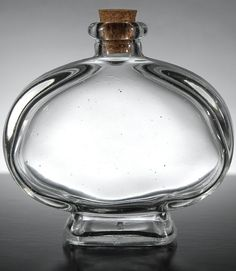 """Oval Clear Glass Cork Top Bottles 3"""" x 4""""   $2.99 each/ 6 for $1.59 each oh, the possiblilites@Jaci Harsch"""