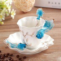 Blue Goldfish Ceramic Coffee Cup with Saucer and Spoon: <ul>  <li>Beautiful European style</li>  <li>Material: Ceramic</li>  <li>Includes one cup, one saucer, and one spoon</li>  <li>Capacity of cup:180ml</li>  <li>Cup: diameter 3.23 inches, height 3.15 inches</li>  <li>Saucer: 6 inches</li>  <li>spoon 4.84 inches</li>  <li>Great for Drinking Tea or Coffee</li>  <li>A great gift for birthday and holidays</li> </ul>