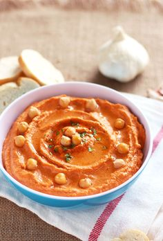 Nice presentation for hummus - a few whole garbanzo beans set aside to decorate/garnish the top.