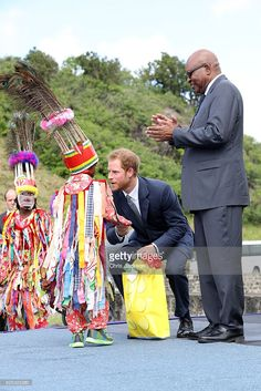 Prince Harry is greeted by cultural dancers at Brimstone Fortress during a youth rally on the fourth day of an official visit on November 23, 2016 in St Kitts, St Kitts and Nevis. Prince Harry's visit to The Caribbean marks the 35th Anniversary of Independence in Antigua and Barbuda and the 50th Anniversary of Independence in Barbados and Guyana.