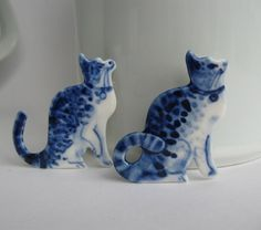 Cat  -  Handpainted Delft porcelain Brooch. $45.00, via Etsy.