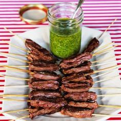 Skirt Steak Skewers with Cilantro-Garlic Sauce  -  Stretch a juicy skirt steak by sliding charred slices on a stick! Perfect for a party filled with small bites.