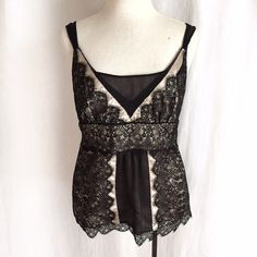 "Ann Taylor Lace Overlay Top✨Host Pick✨ Elegant champagne/buff overlaid with black lace and a sheer lined panel. The straps are spaghetti style with a wider chiffon over top. Fully lined so that even the sheer part in front and back are not see through. Invisible side zipper closure. Body 100% polyester; lace 100% nylon; woven overlay 100% silk. Dry clean. Size 4P petite. Bust: 16"" flat across.  Waist: 15"" across.  Length: 23"" plus 1"" lace hem. EUC. Thanks for looking! Ann Taylor Tops"