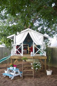 Country Cute: This chic little space combines everything into one. With a slide, tent, and loft, this playhouse is quite the creative space. Source: Flickr User pannylife