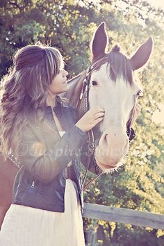 Love everything!!!! Her hair style! Her dress! The horse!!!! (Would exchange leather jacket for denim jacket!)