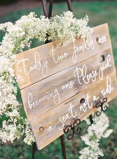 today two families are becoming one. Please pick a seat not a side. Sign wrapped with baby breath... love it!