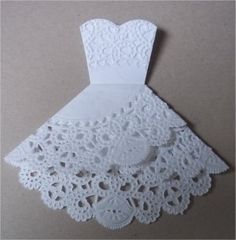 Doily folding into wedding dress!! Love this idea!! --wish it wasn't glued together so it could be opened with wedding details inside