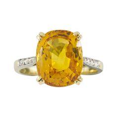 An orange sapphire and diamond ring - Bentley & Skinner