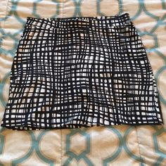 Black and white Forever 21 skirt Black and white Forever 21 skirt. Tag says size large but more true to a size medium. Some slight wear near waist. Forever 21 Skirts Mini