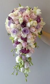 flower: Bride Bouquet: white roses, pink roses, mauve roses, white lisianthus, pink lisianthus and white singapore orchids Bouquet En Cascade, Cascading Wedding Bouquets, Purple Wedding Flowers, Bride Bouquets, Flower Bouquet Wedding, Pink Rose Flower, Peach Flowers, Rosa Rose, Artificial Flowers