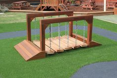 A clatter bridge we made for Gwandalan Preschool. This piece is made from iron wood sleepers attatched to chains and spotted gum hard wood for the frame and ramp. If you're interested in purchasing custom equipment from us please email or call us. #playground #syntheticgrass #softfall #playequipment #custommade #fun #rubberwetpour Play Equipment, Epoxy Floor, Commercial Flooring, Hard Wood, Wet And Dry, Newcastle, Garden Bridge, Rainbow Colors, All The Colors