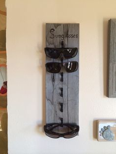Sunglasses Holder. Made with a pallet board and picture hangers.