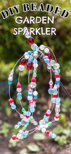 With some beads, pliers, floral wire, hot glue, and a garden stake you'll be on your way to watching your beautiful beaded garden sparkler dance in the sunlight! A garden sparkler adds a sense of fun to any outdoor space, resembling a firework with its weeping strands of colorful beads. Recycled Crafts, Diy Crafts, Decorative Garden Stakes, Green Craft, Spring Crafts For Kids, Spring Activities, Craft Tutorials, Craft Ideas, Wedding Crafts