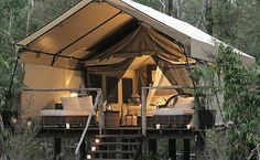 Paperbark Camp deluxe tent~Size: 10 square meters.   safari tents are built off the ground on a timber platform and include a deck with outdoor furniture, an open-air ensuite with hot shower and mosquito screening.