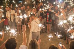 I would LOVE to have everyone with a long sparkler going during our first dance.