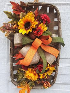 Tobacco basket floral, sunflower tobacco basket, tobacco basket with wreath, tobacco basket wall dec Tobacco Basket Decor, Basket Crafts, Autumn Decorating, Porch Decorating, Decorating Ideas, Fall Wreaths, Door Wreaths, Basket Decoration, Baskets On Wall