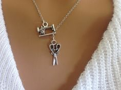 Sewing machine necklace by Ashijewelers on Etsy
